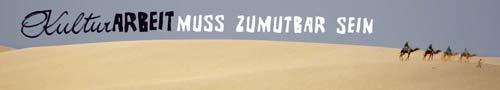 Plakat: KulturARBEIT muss zumutbar sein, Wüste mit Karavane von 4 Kamelen.