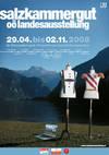 Plakat zur Landesausstellung, 1 Kleiderständer mit Hosenträgern und 1 Kleiderständer mit Rot Weiß Rot Shärpe.